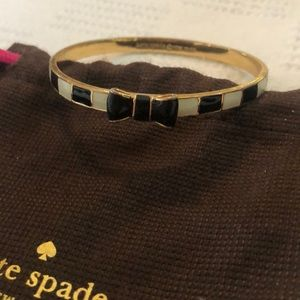 Kate Spade black and white striped bangle with bow